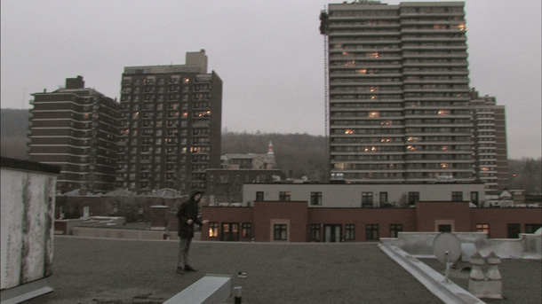 Sean Nicholas Savage on a roof